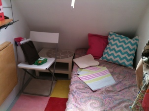 This is my bed! and the little table. The bed turns into a chair thing, and I love these sheets I bought from Zara home.