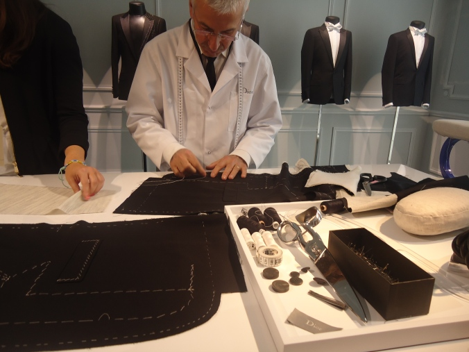 A menswear tailor showed all the detailed business of a suit.